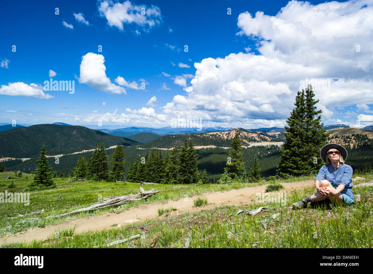Lone woman pausing to enjoy the view, Monarch Crest Trail, Central Colorado, USA - Stock Image