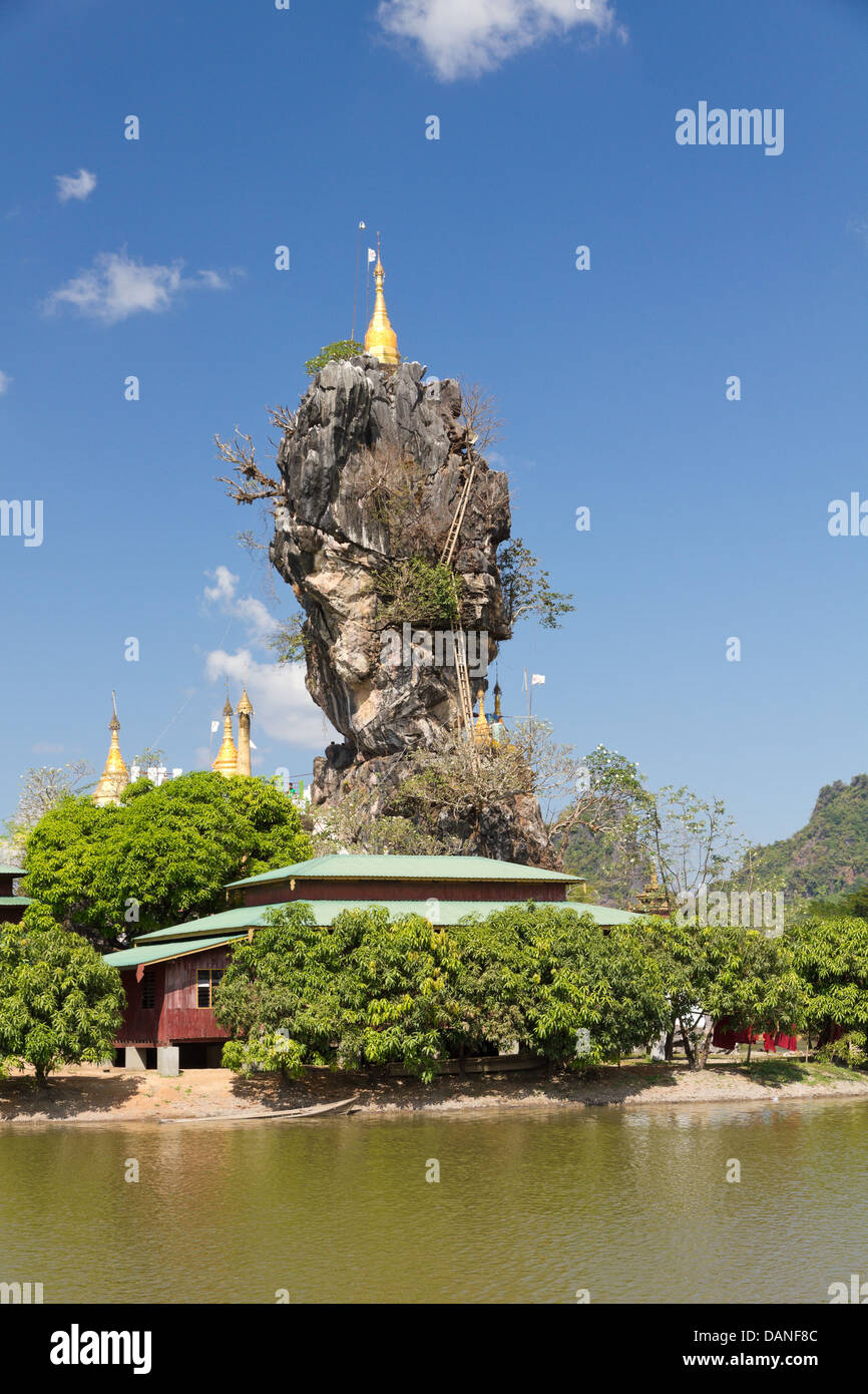 rock pinacle with golden stupa on temple island, Hpa An, Burma Stock Photo