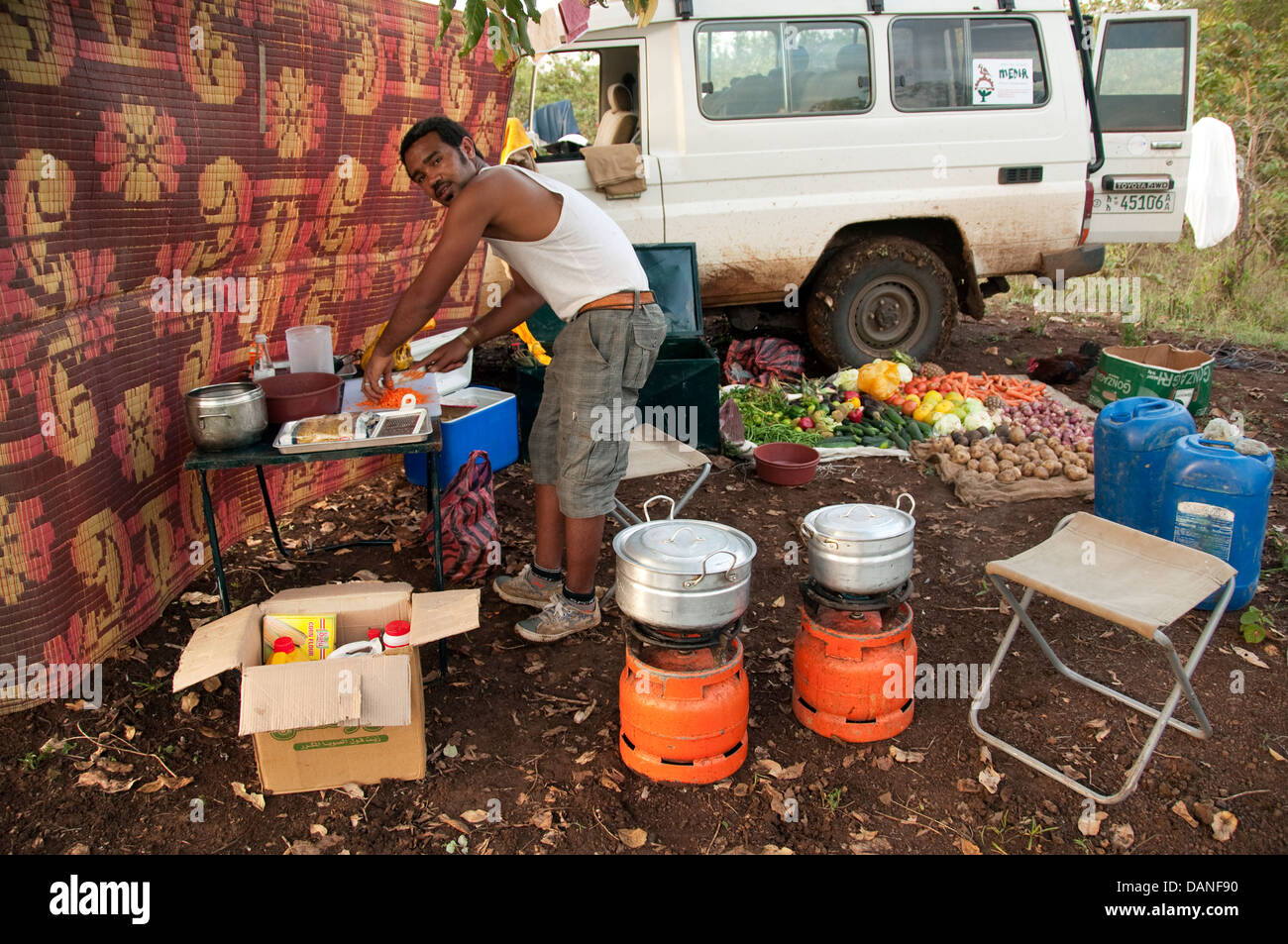 African cook in a camp kitchen, Ethiopia - Stock Image