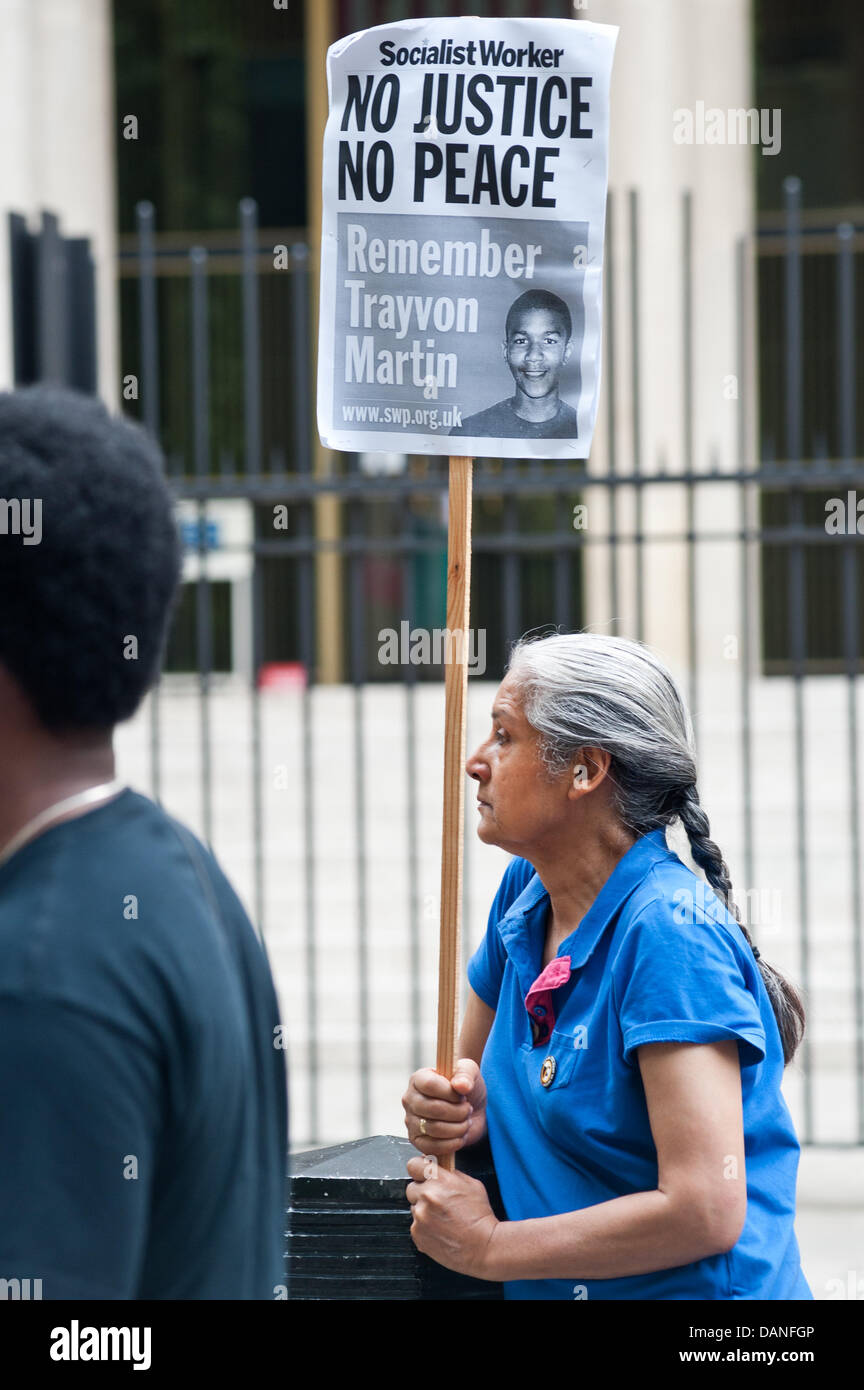 London, UK. 16th July, 2013. a demonstrator holds a placard reading 'No justice No Peace, Remember Trayvon Martin' - Stock Image