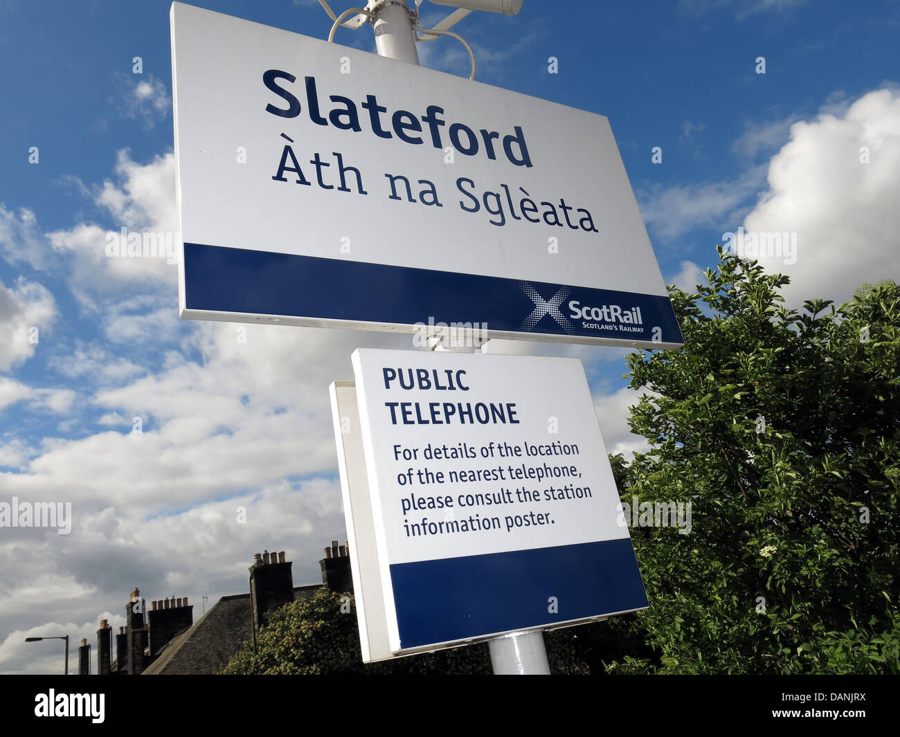 Multi-lingual sign in Slateford Railway Station in Edinburgh Scotland UK - Stock Image