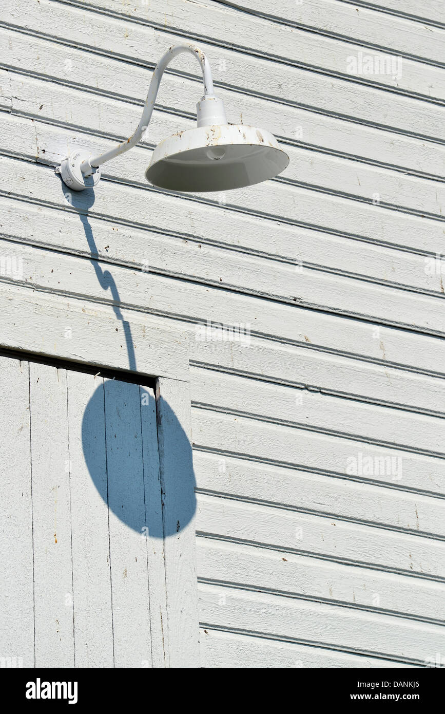 Light fixture on a barn in Oregon's Wallowa Valley. - Stock Image