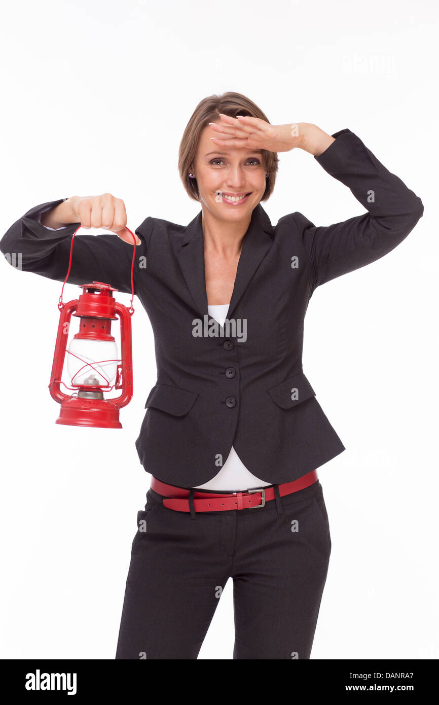 Businesswoman stay with red kerosene lamp isolated on white - Stock Image
