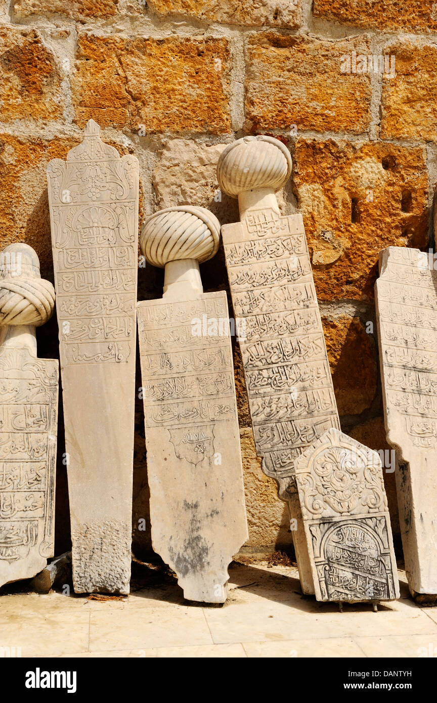 Old tombstones in courtyard of Isabey Mosque (14th Century) in Selcuk, Aegean Coast, Turkey - Stock Image