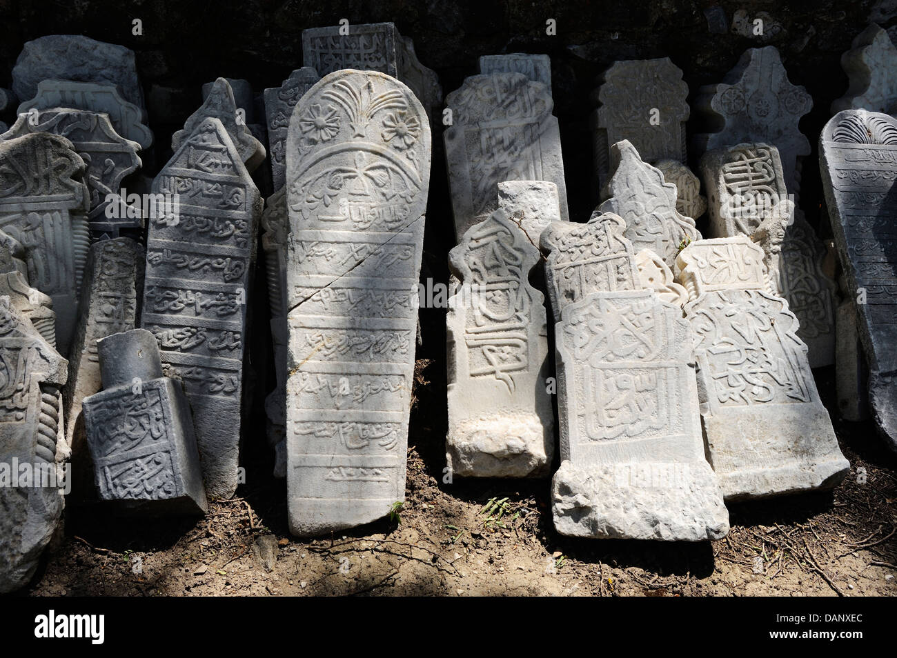 old tombstones in outer courtyard of Ilyas Bey Mosque (15th Century) at Miletus, Aegean Coast, Turkey - Stock Image
