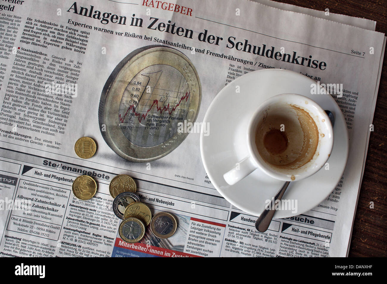 (ILLUSTRATION)An illustration dated 13 July 2011 shows an empty espresso cup on top of the economic advice - Stock Image