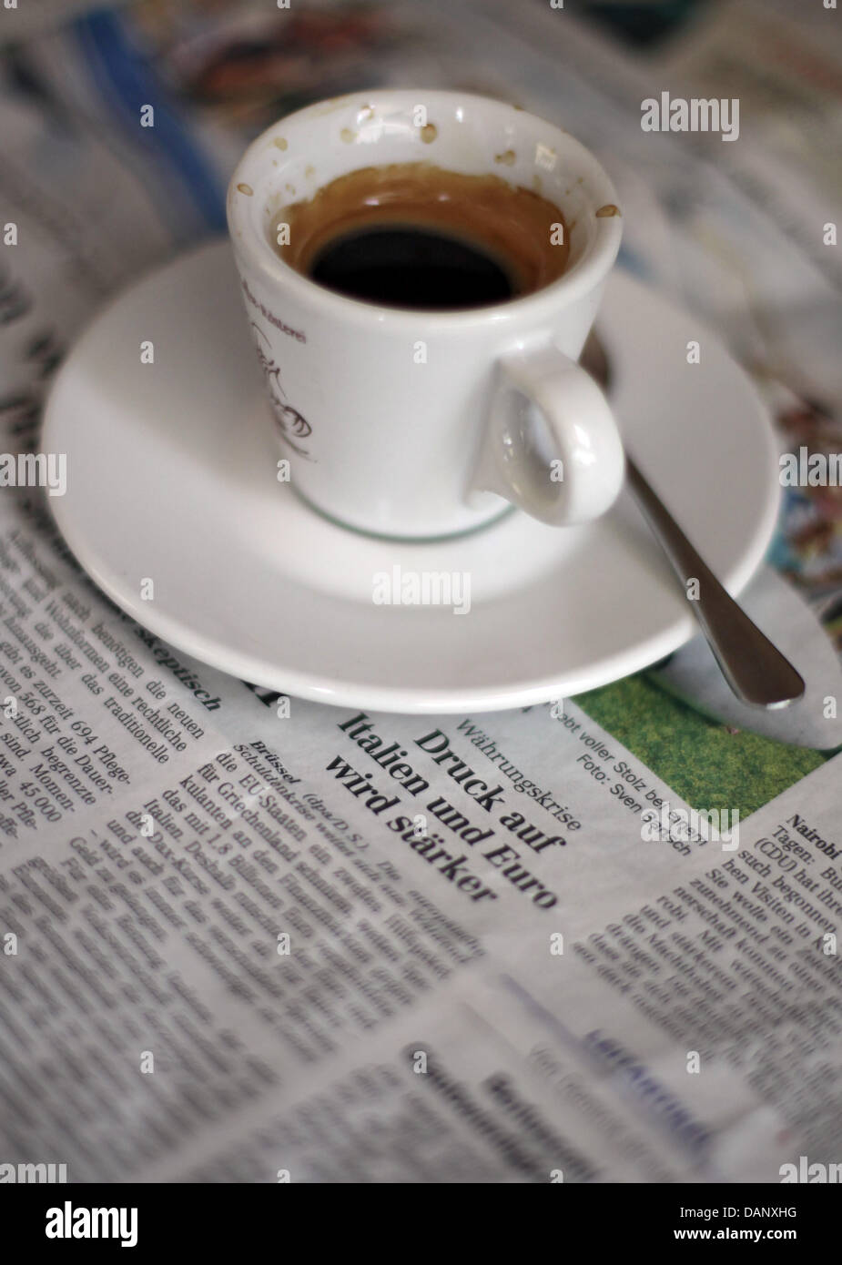 (ILLUSTRATION)An illustration dated 13 July 2011 shows an espresso cup on top of the economic advice section - Stock Image