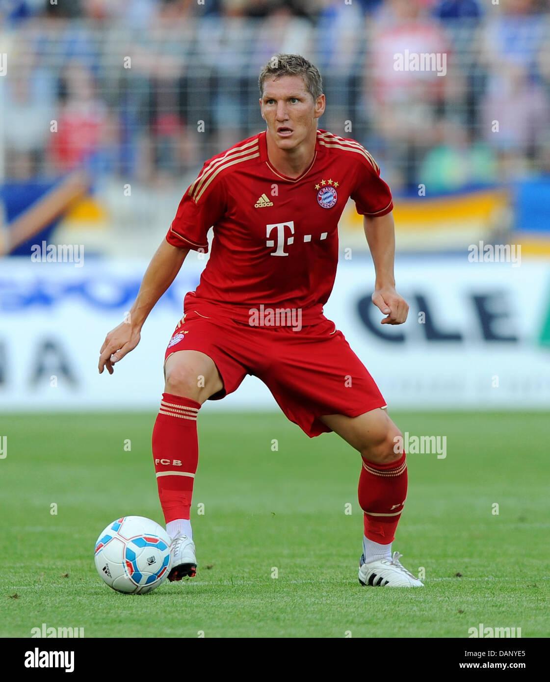 Bastian Schweinsteiger of FC Bayern Munich controls the ball