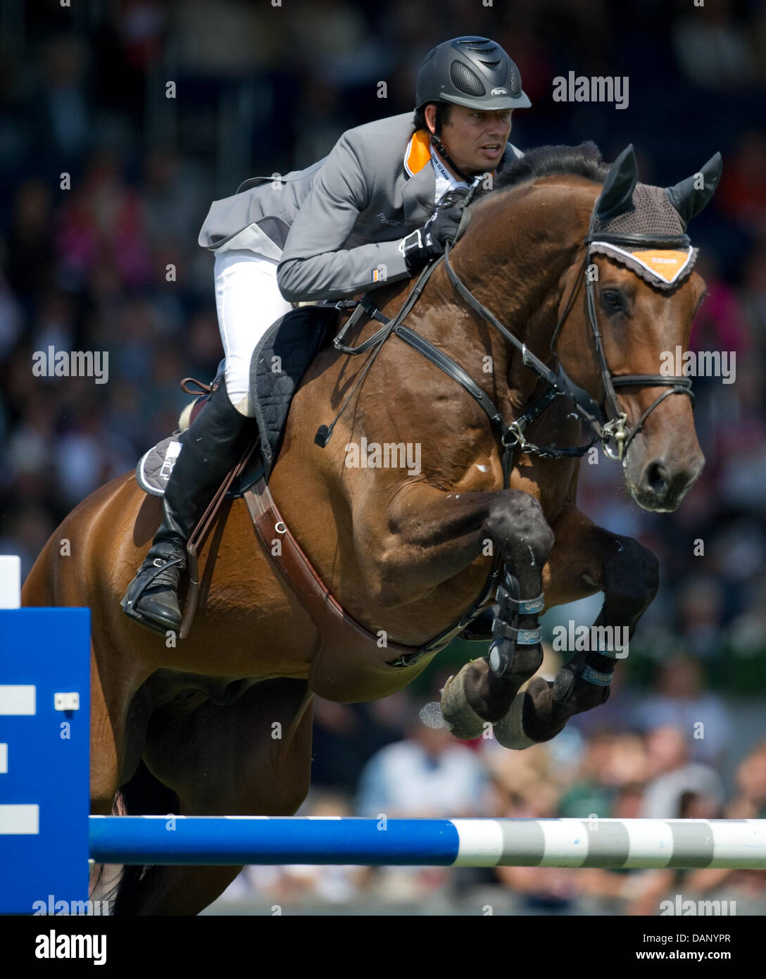 German equestrian Marco Kutscher jumps with his horse Cash during the CHIO show jumping for the North Rhine-Westphalia Stock Photo