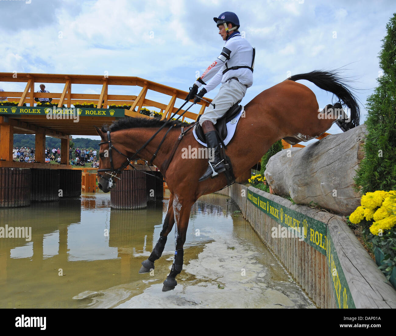 British eventing equestrian William Fox-Pitt jumps over a natural obstacle with his horse Neuf des Coeurs during - Stock Image