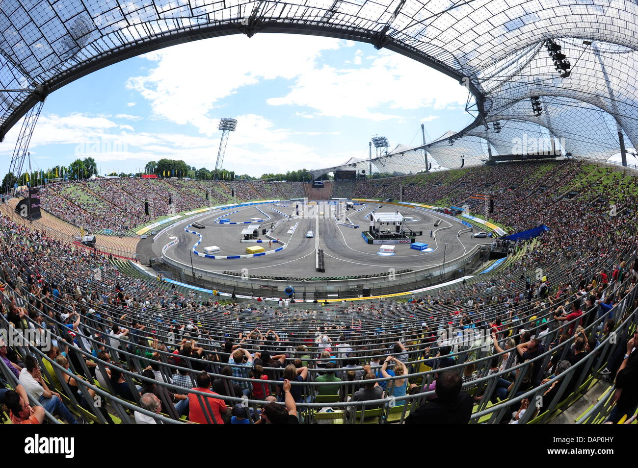Numerous fans of the German Touring Car Masters (DTM) watch a show event at the Olympic Stadium in Munich, Germany, - Stock Image