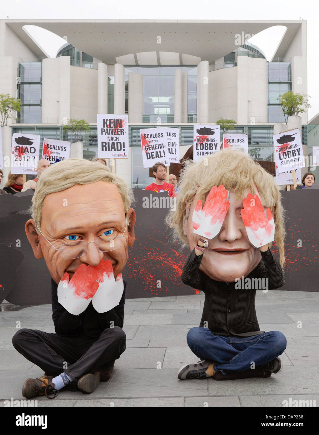 Dressed as Foreign minister Westerwelle (L) and Chancellor Merkel (R) activists of the organisation Campact demonstrate Stock Photo