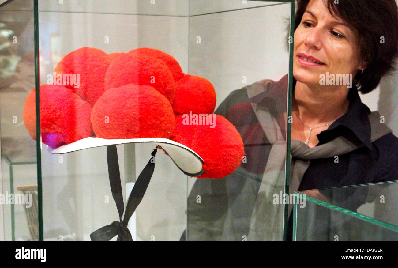 A visitor views a Schwarzwald Bollenhut during the preprensentation of the exhibiton titled 'Chapeau! Berühmte - Stock Image