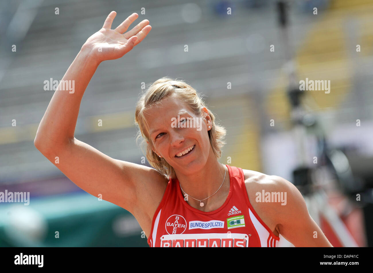 Finishing runner of 100 meter relay team of TSV Bayer 04 Leverkusen, Jennifer Oeser cheers about winning the German - Stock Image