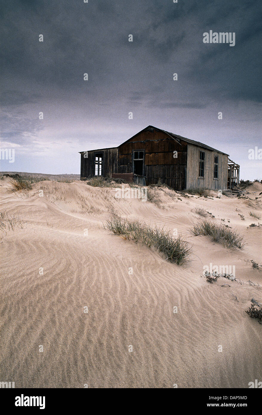 A old abandoned diamond dwellers house in the Namib desert, Namibia - Stock Image