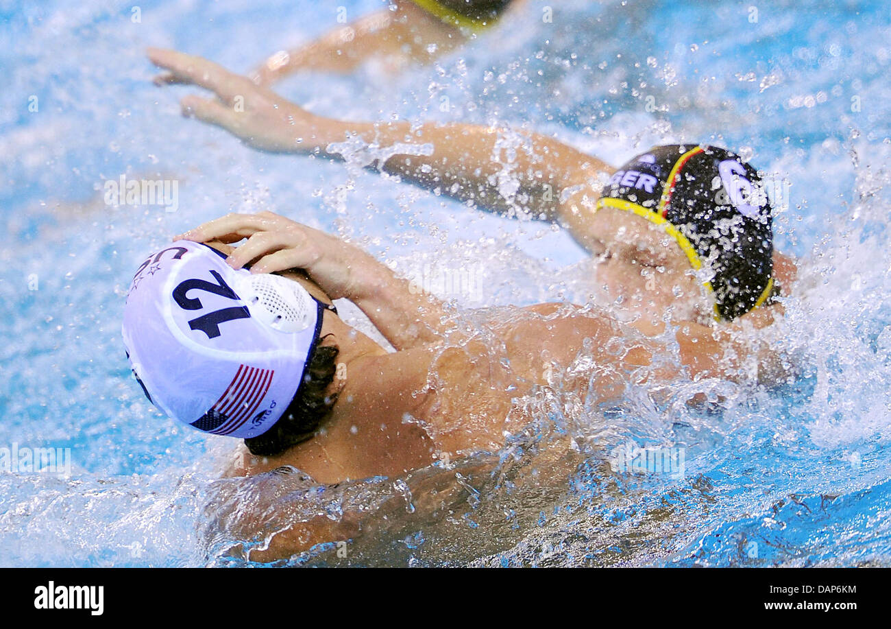 Germany's Marc Torsten Politze (R) and Shea Buckner of USA challenge during their men's waterpolo 5th-8th - Stock Image