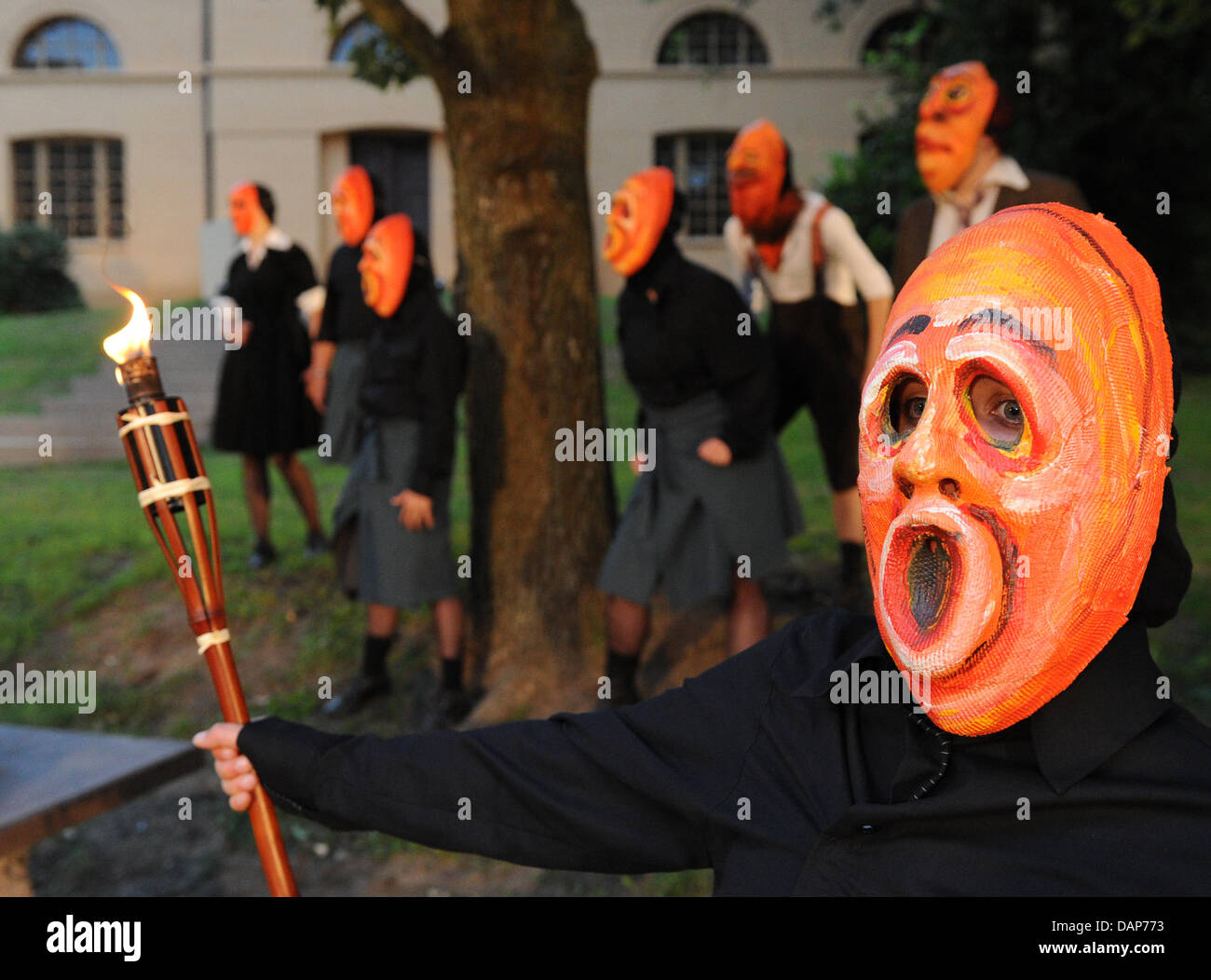 Actors With Huge Masks Perform In The Piece Scherz Satire