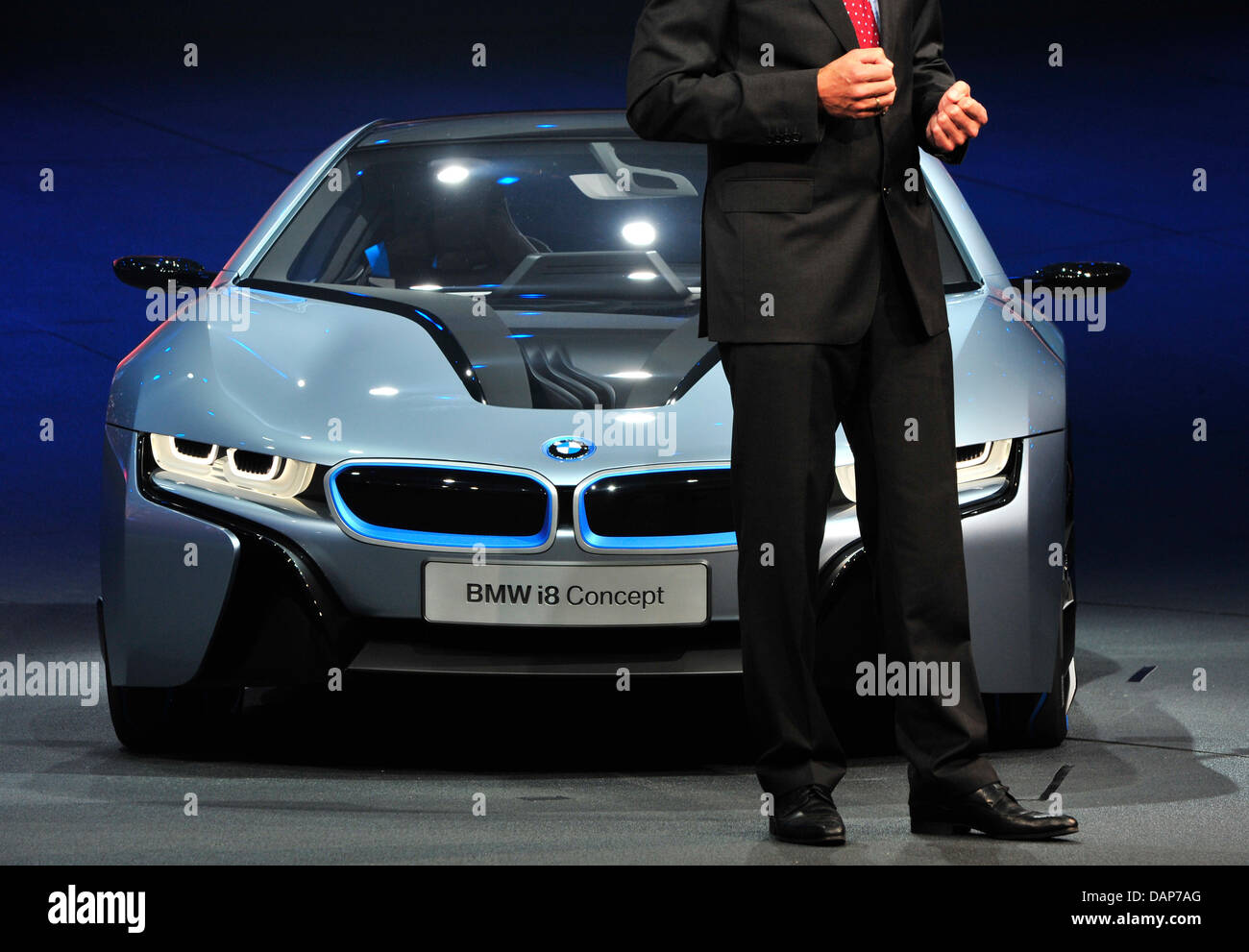 Development Director Klaus Draeger Stands In Front Of A Bmw I8