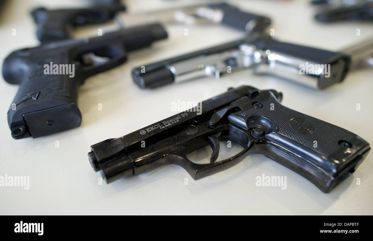 A Police Officer Puts Seized Gun Next To Other Weapons In Heidelberg Germany 10 August 2011 The Of Numerous Guns During