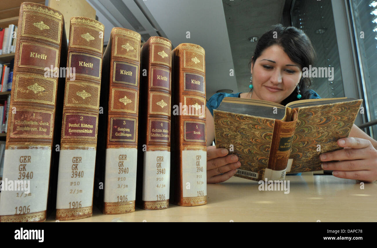 Student Roxana Ajib (25) reads passages of a book volume of Kleist at the Thuringian University and State Library Stock Photo