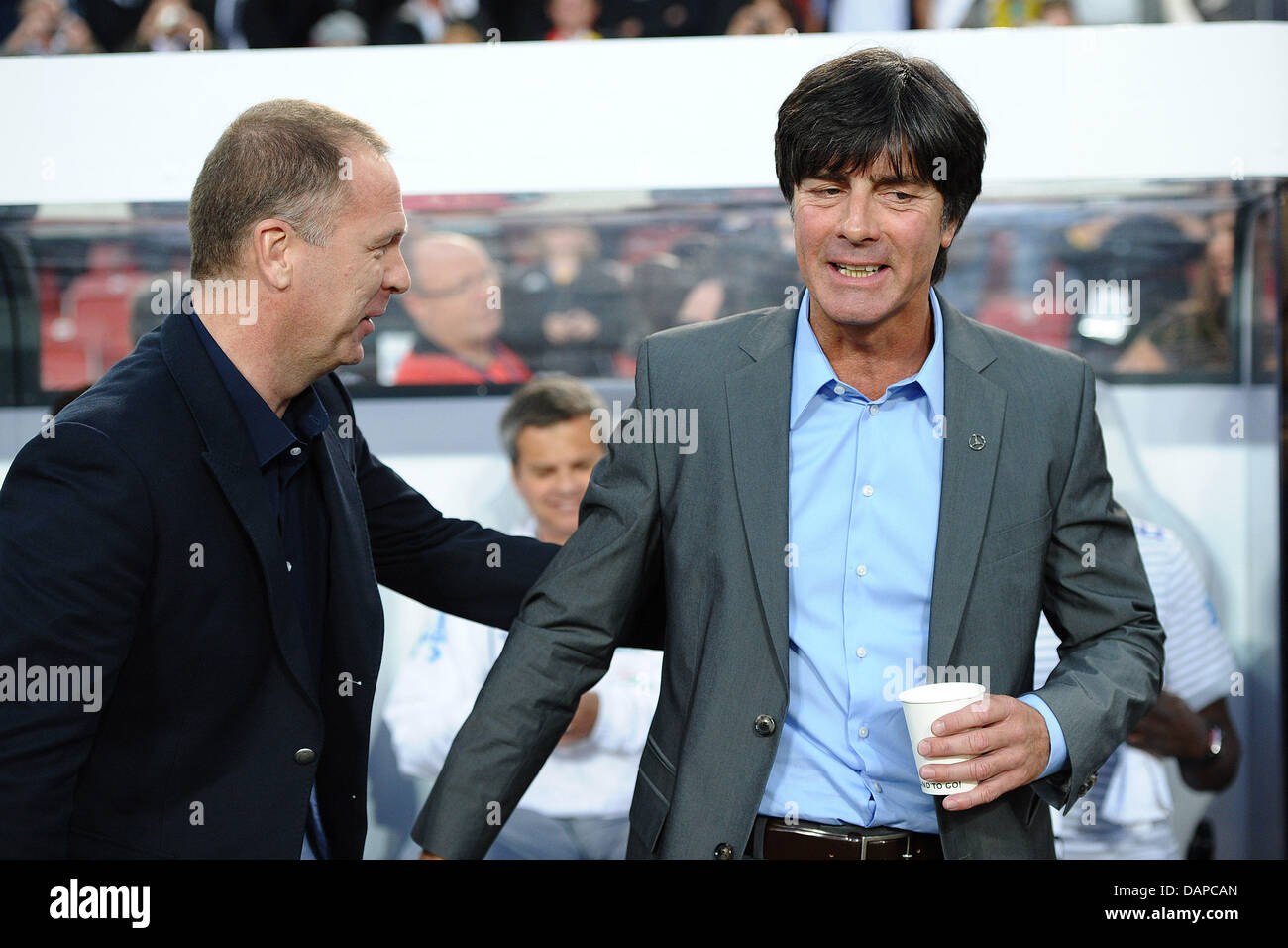 Germany head coach joachim loew r and brazilian head coach mano germany head coach joachim loew r and brazilian head coach mano menezes greet each other prior to the friendly soccer match germany vs m4hsunfo