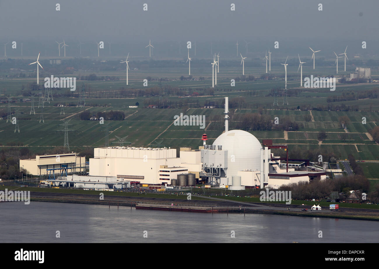 FILE - An archive picture dated 24 April 2010 shows the nuclear power plant Brokdorf in front of wind wheels in Stock Photo