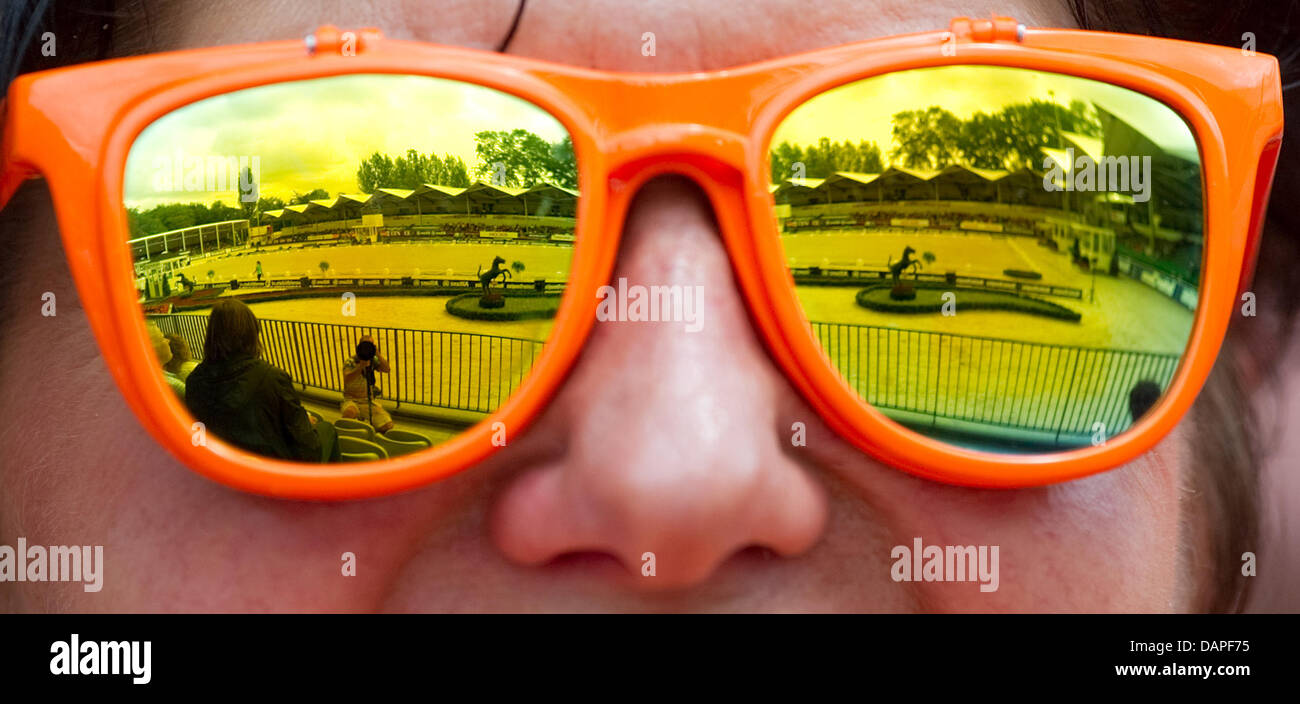 f7ec1fb9cf33bb Sunglasses of a Dutch fan mirrors a dressage ring during the team  competition of the FEI European Dressage Championships in Rotterdam