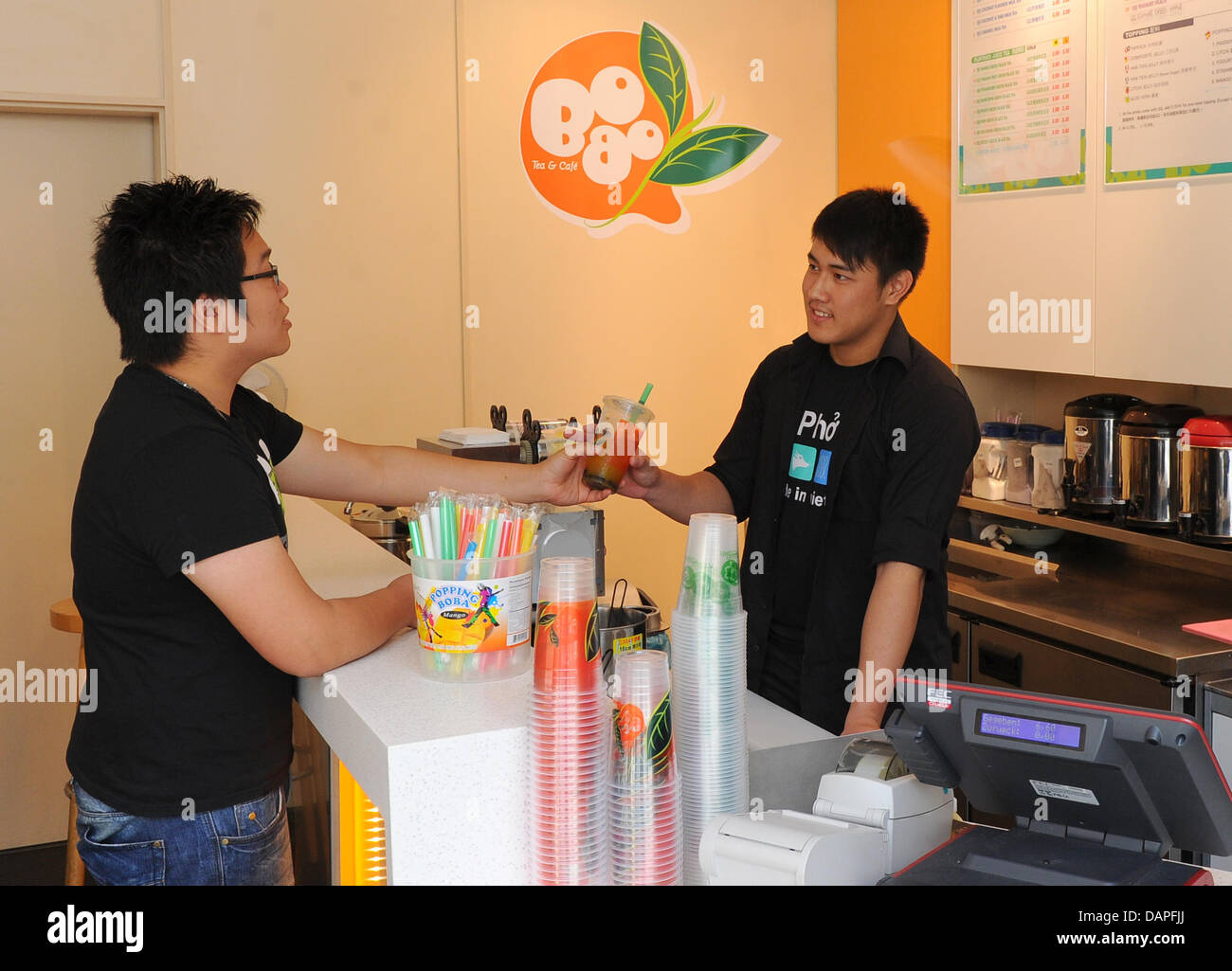 A Young Man Buys The Latest Cult Drink Bubble Tea Or Bubble Milk Tea Stock Photo Alamy