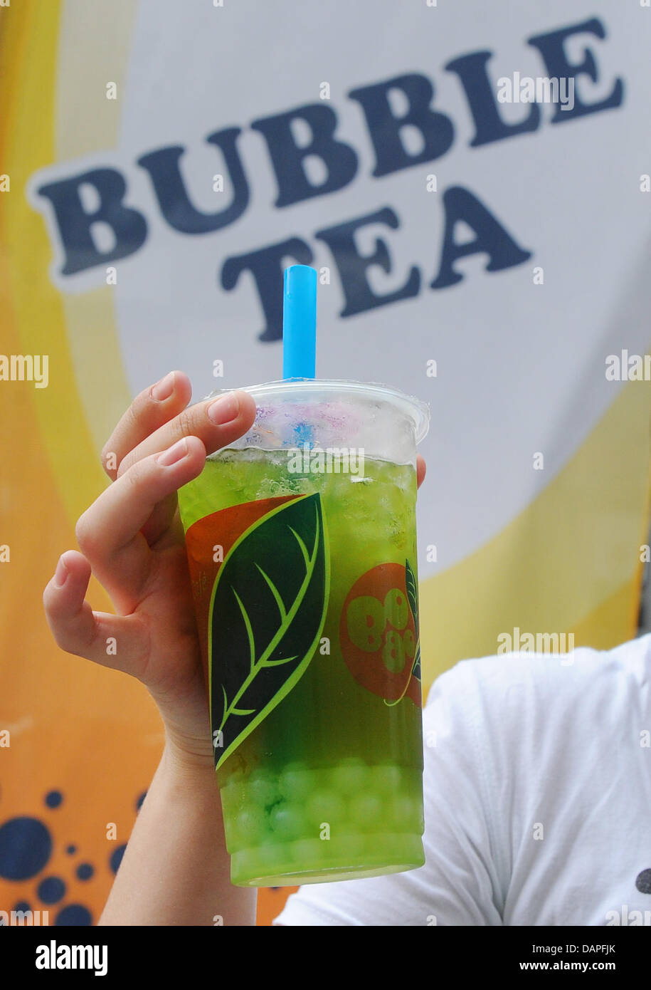 A Young Woman Holds A Cup Of The Latest Cult Drink Bubble Tea Or Stock Photo Alamy