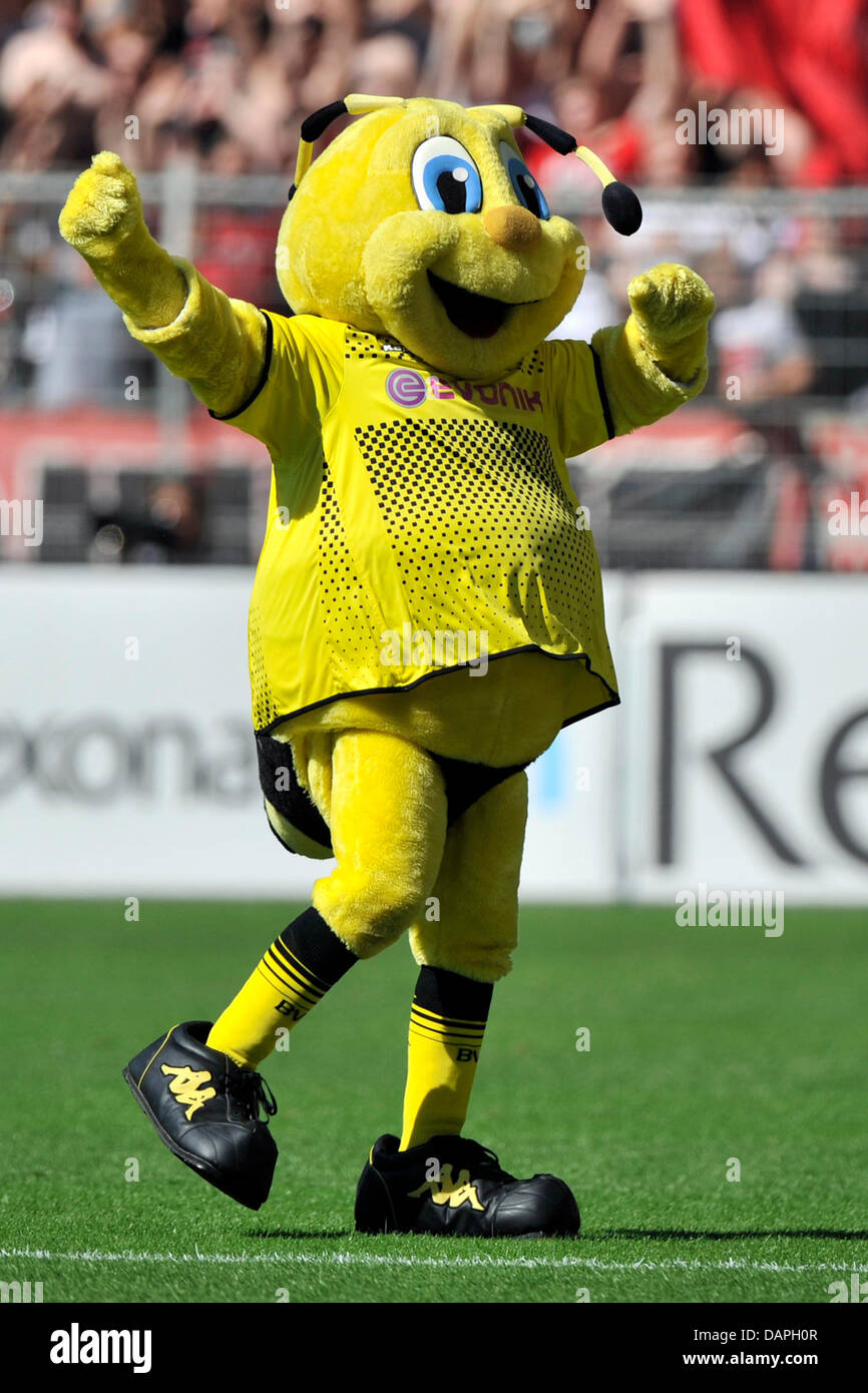 Dortmund S Mascot Emma Walks Across The Pitch During The Bundesliga Stock Photo Alamy