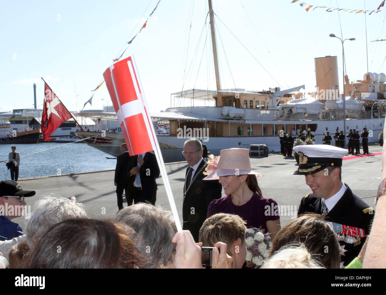 Danish Crown Prince Frederik (R) and Crown Princess Mary arrive in Skagen, Denmark, during the summer tour of the - Stock Image