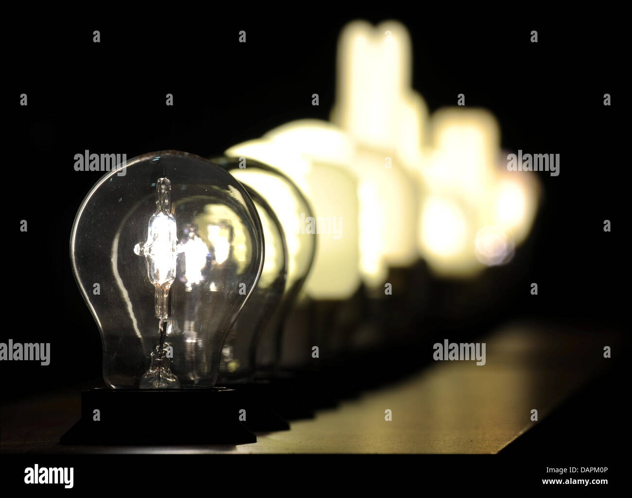 Energy saving lamps of diffennt types shine during a press conference of the Consumer Protection Society Stiftung - Stock Image