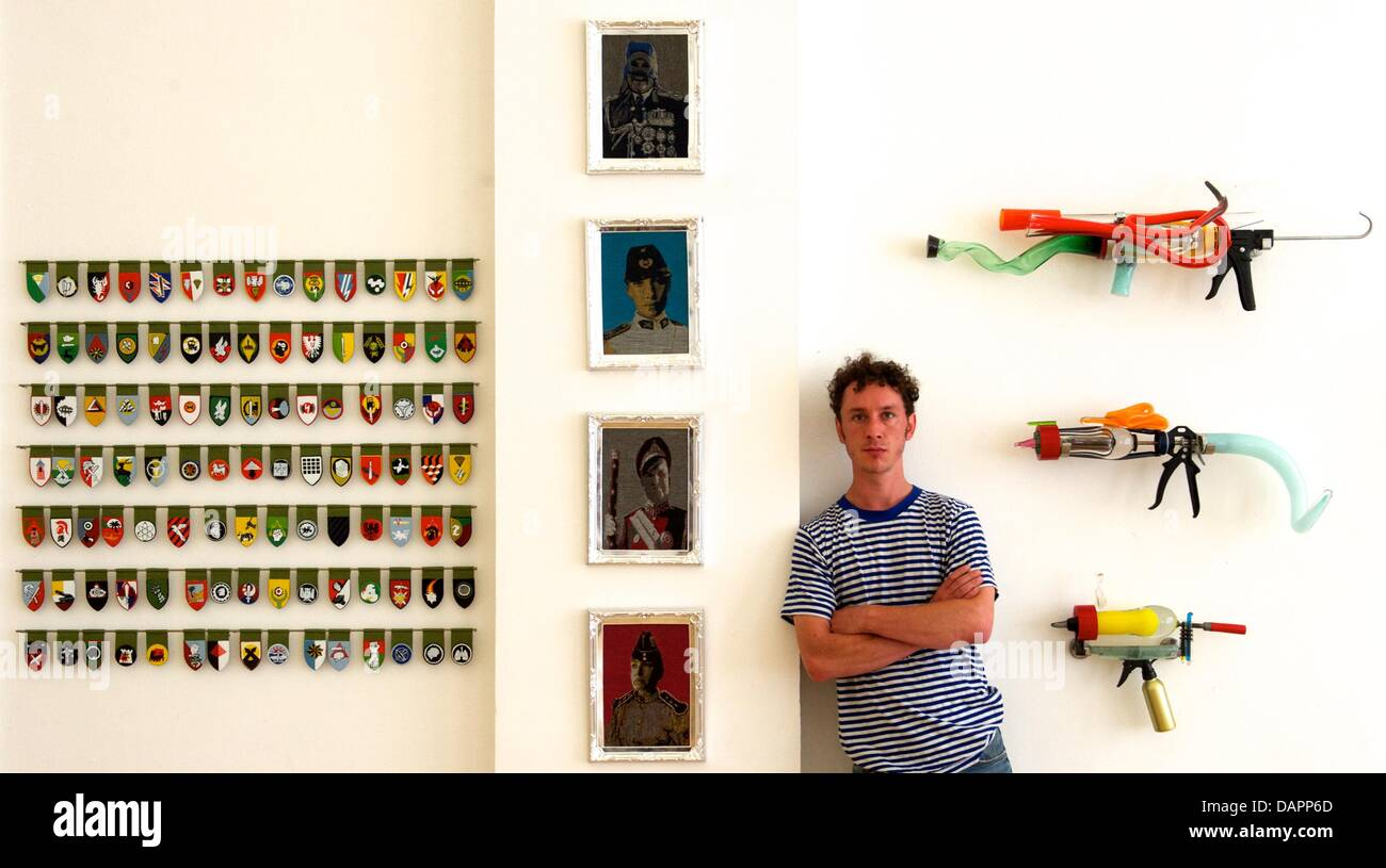 Student Wilhelm Frederking stands among his artworks (L-R) 'Abzeichen' (2012), 'Ahnengalerie' (2012) - Stock Image