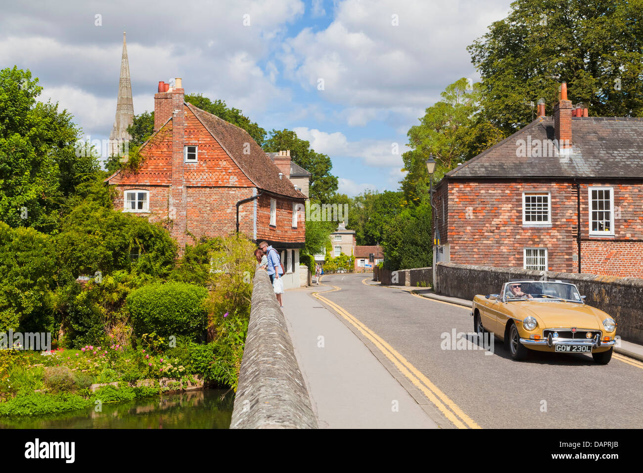 England, Wiltshire, Old Roadster on bridge over River Avon - Stock Image