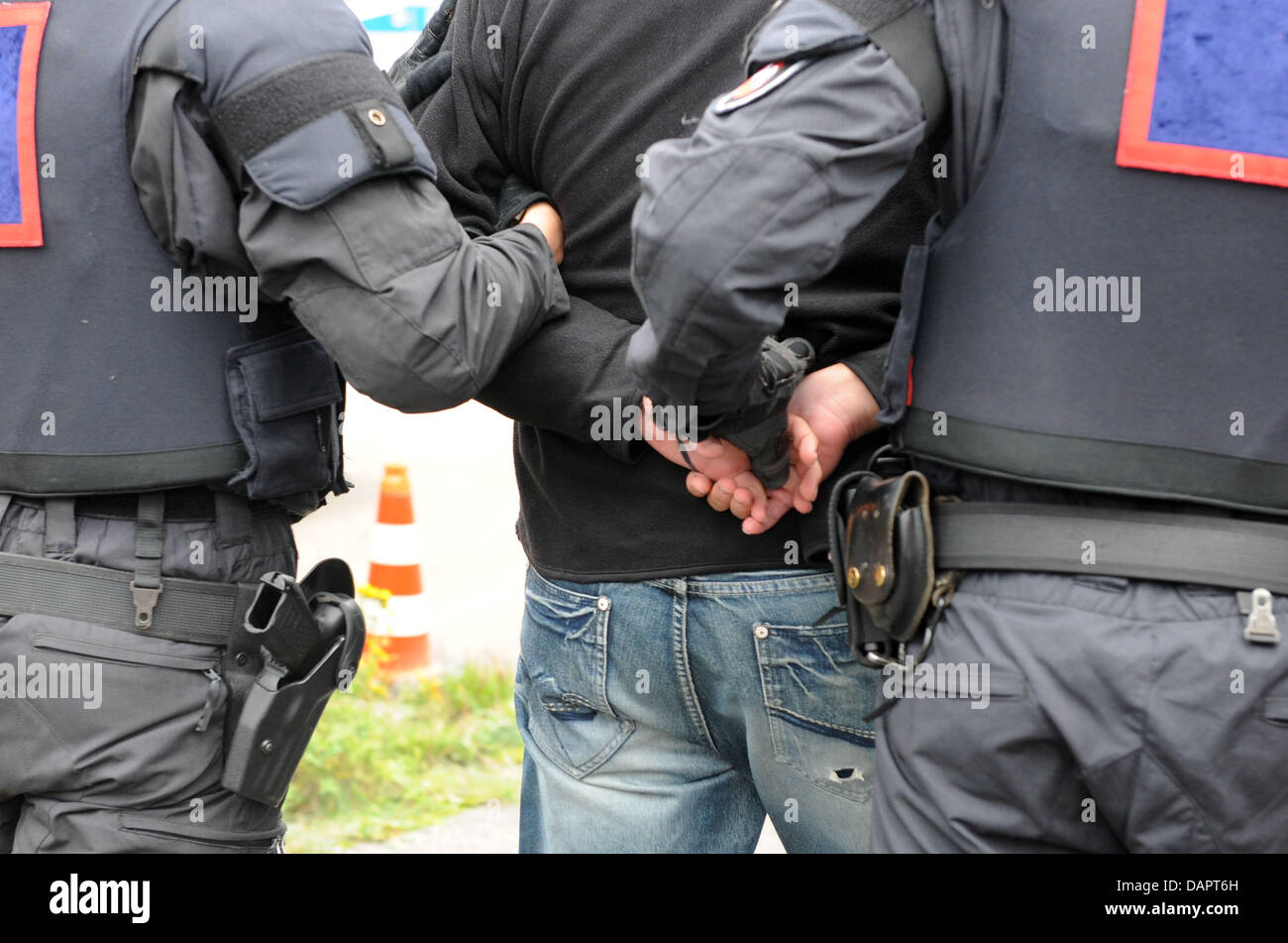 Police officers arrest a demonstrator during a drill inCelle,Germany, 30August 2011. The Lower - Stock Image
