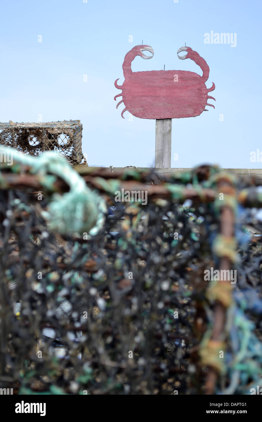Crab sign and crab nets, Blakeney Channel, Norfolk. - Stock Image
