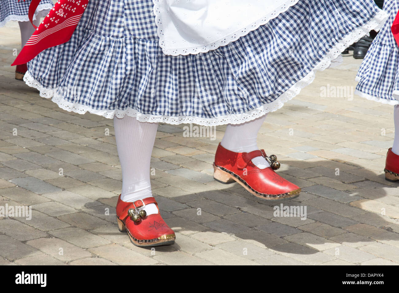 Portrait of a traditional folk dancer at the Bakewell Day of Dance 2013. Red shoes and bells - Stock Image