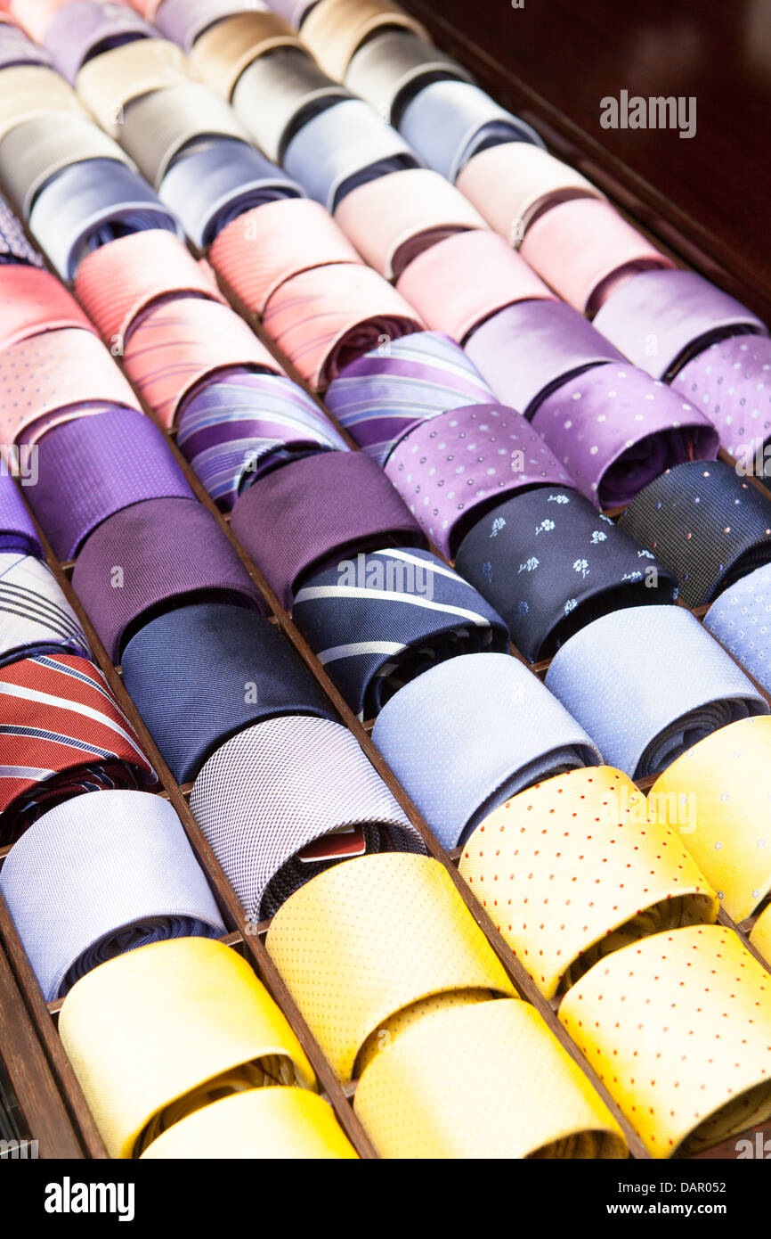 Ties on a shelf display in a boutique store in Melbourne, Australia - Stock Image