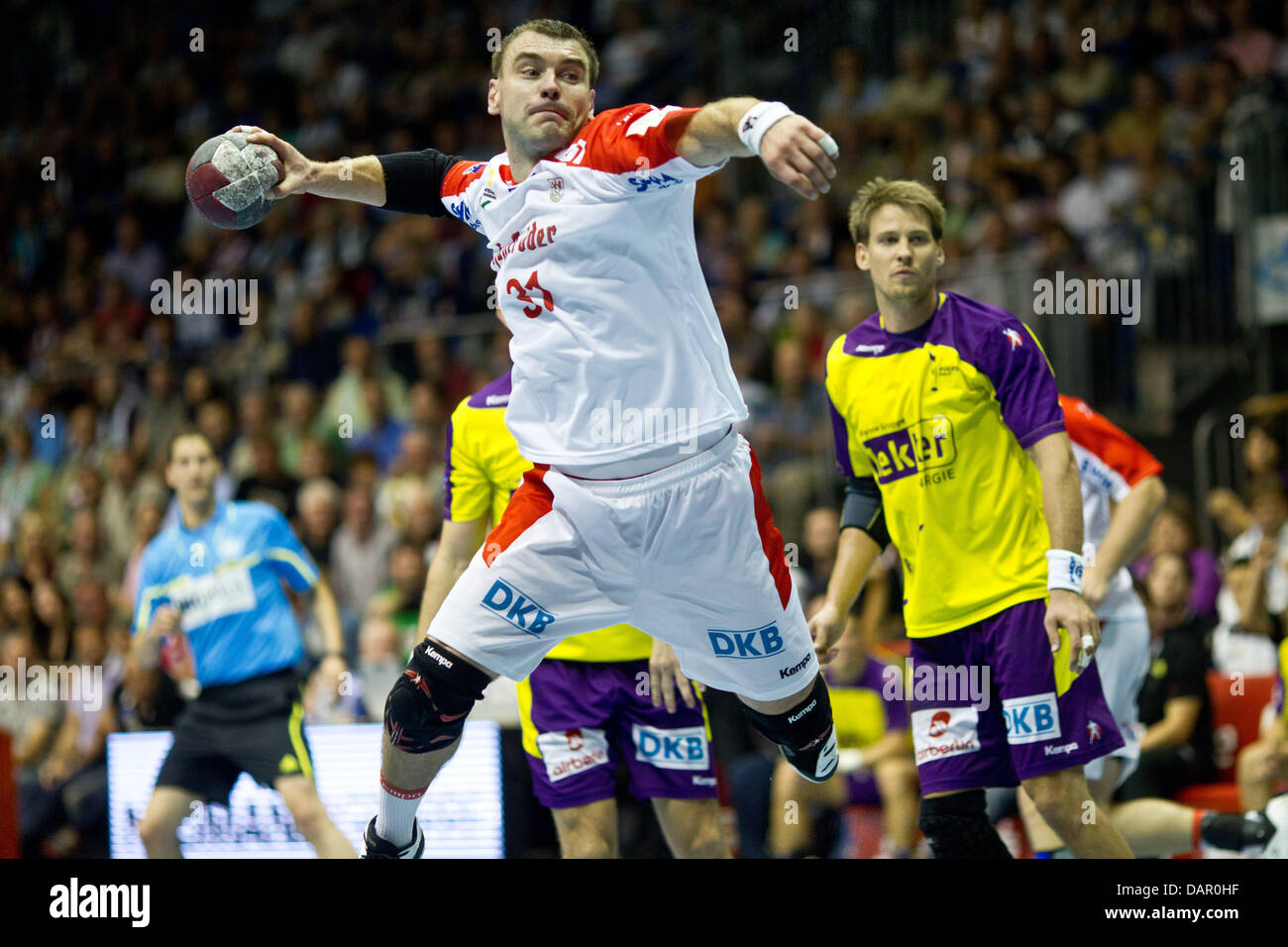 Magdeburg's Bartosz Jurecki throws the ball during a handball match of SC Magdeburg against Fuechse Berlin in - Stock Image