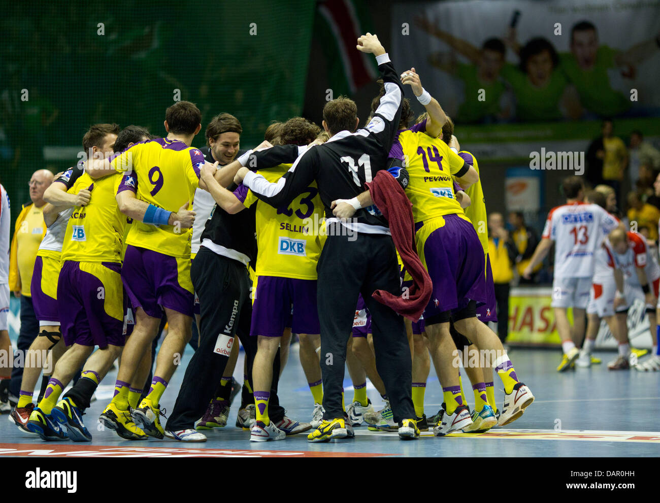 Berlin's team players cheer after winning the handball match of SC Magdeburg against Fuechse Berlin by 29-27 - Stock Image