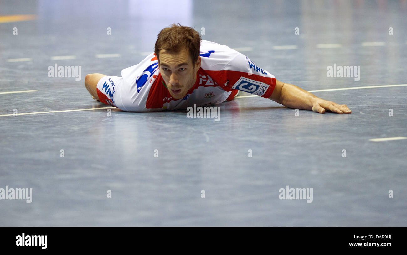 Magdeburg's Jure Natek lies on the ground during a handball match of SC Magdeburg against Fuechse Berlin in - Stock Image
