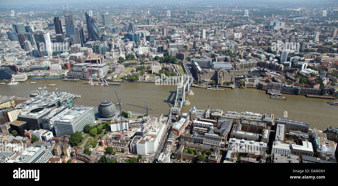 aerial view of London from Bermondsey across the Thames with the Tower of London, City Hall, Tower Bridge and the - Stock Image