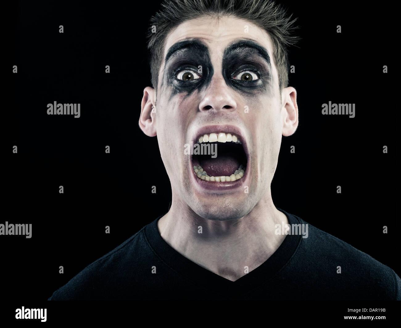 Scary man screaming - Stock Image