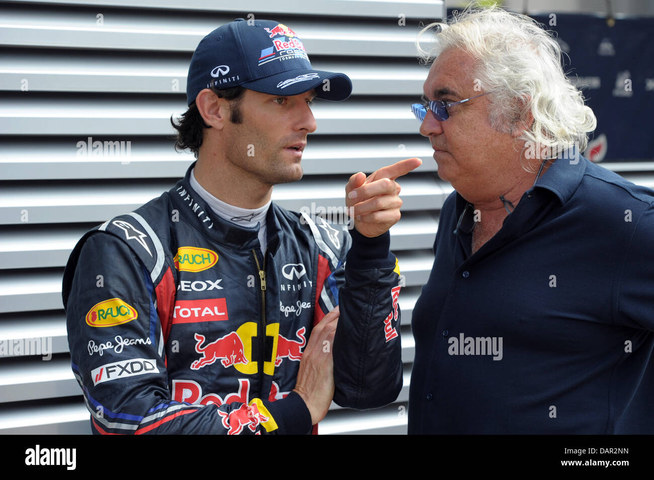 45dd0bbf6c9 Australian Formula One driver Mark Webber (L) of Red Bull chats with  Italian Flavio Briatore