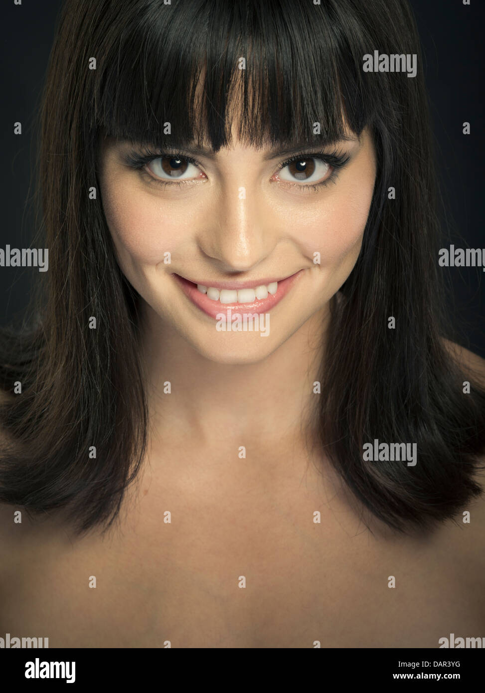 Beautiful latina woman dark brown brunette hair high cheekbones big smile. - Stock Image
