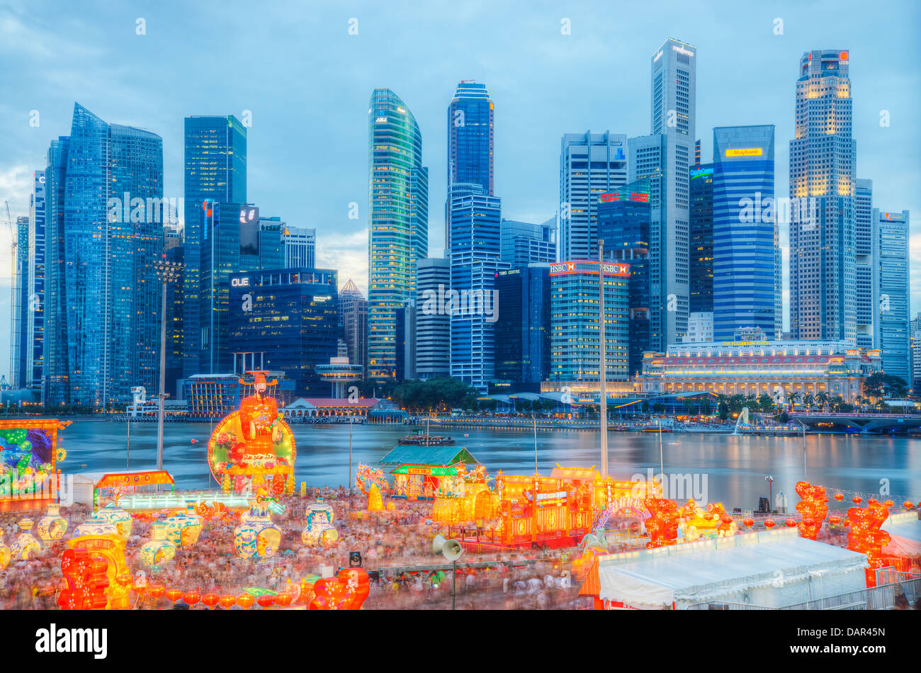 Singapore cityscape with God of Fortune - Stock Image