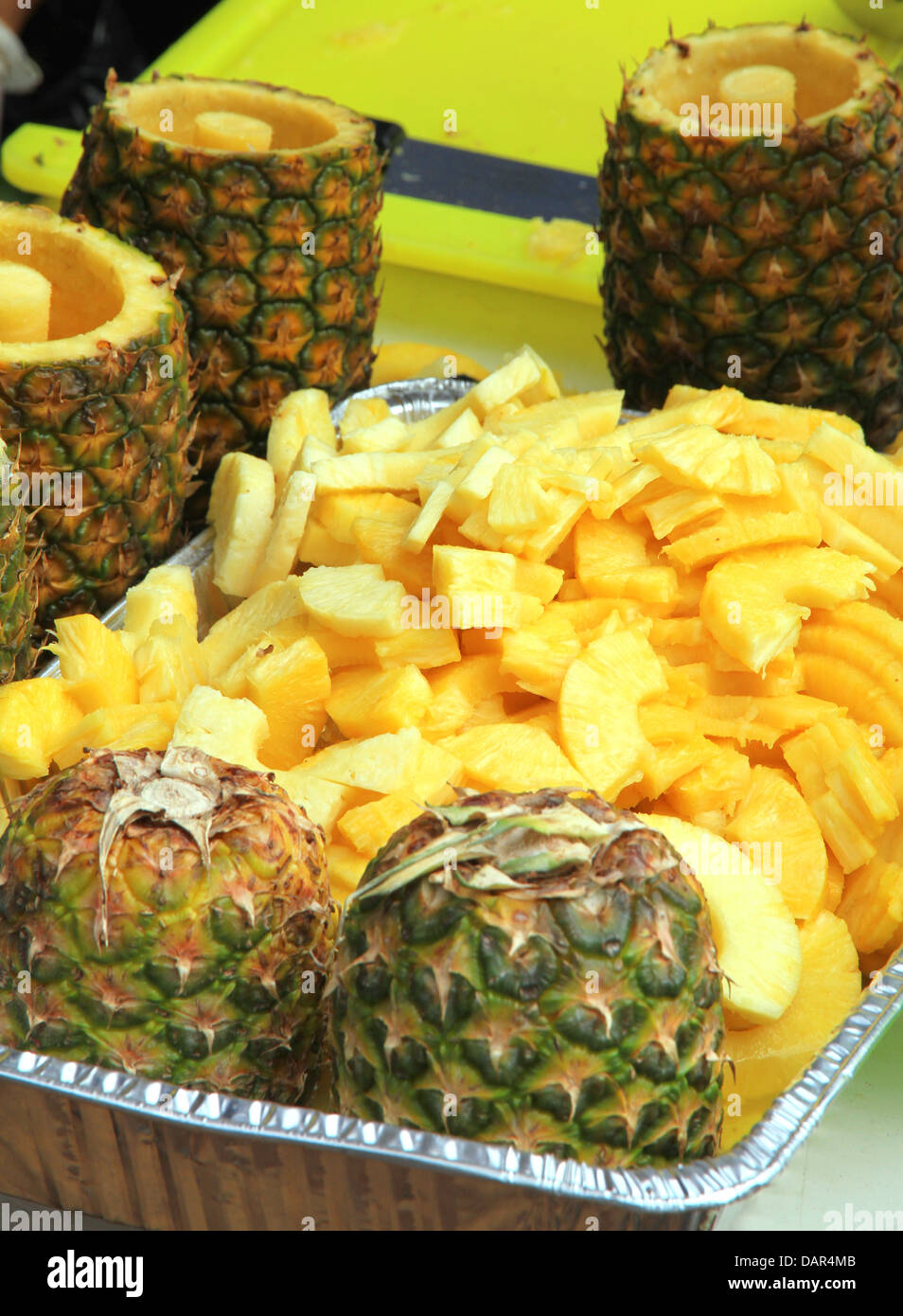 Sliced and carved pineapple at a food stand in toronto canada