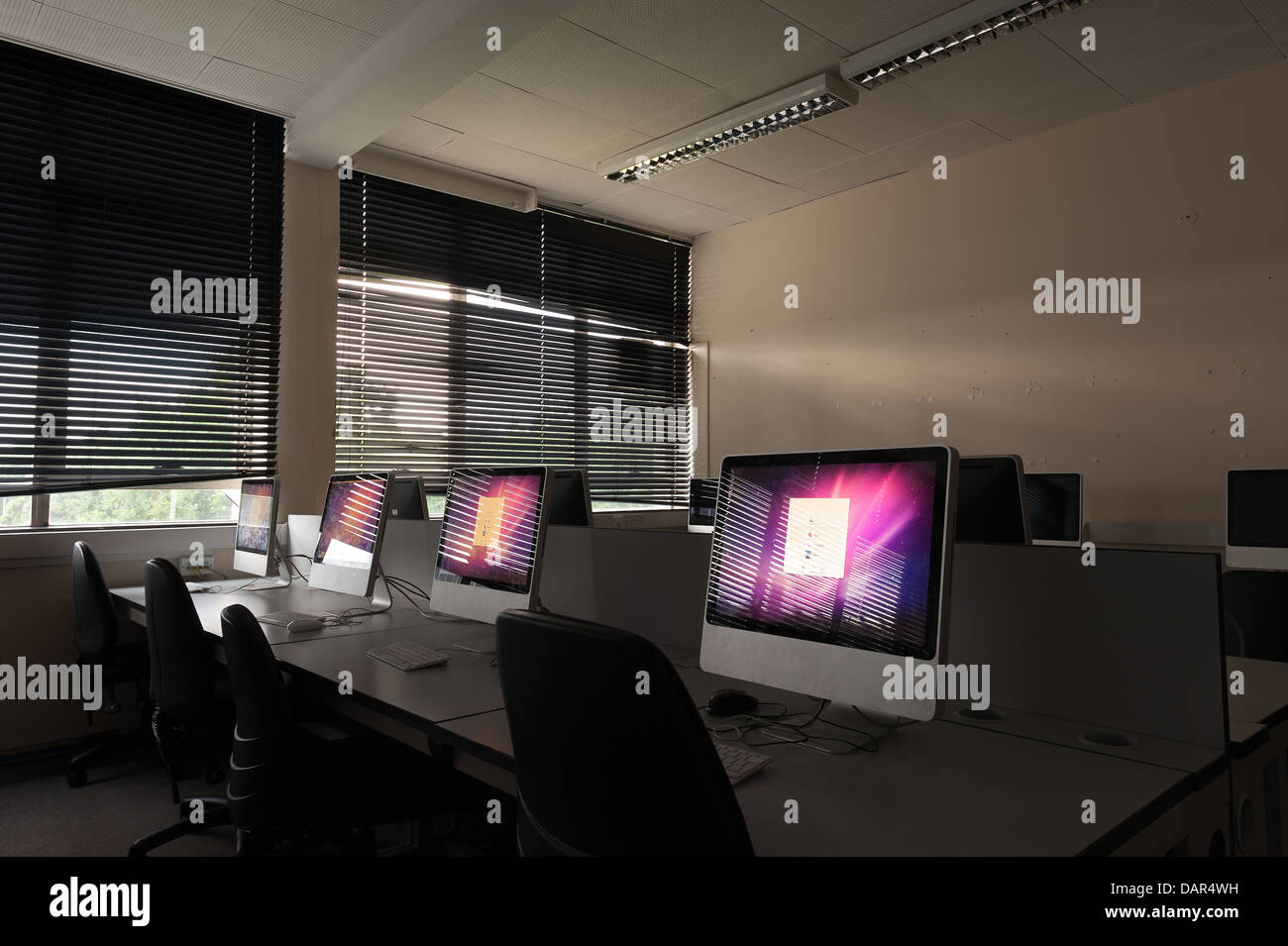 the end of school or college as we know it rows of computers in a darkened classroom previously much used now waiting - Stock Image