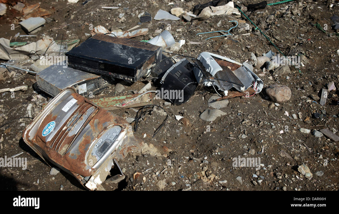 Rusty electrical appliances left behind by the receding water at the badly damaged  Ishinomaki 1 year after the Stock Photo