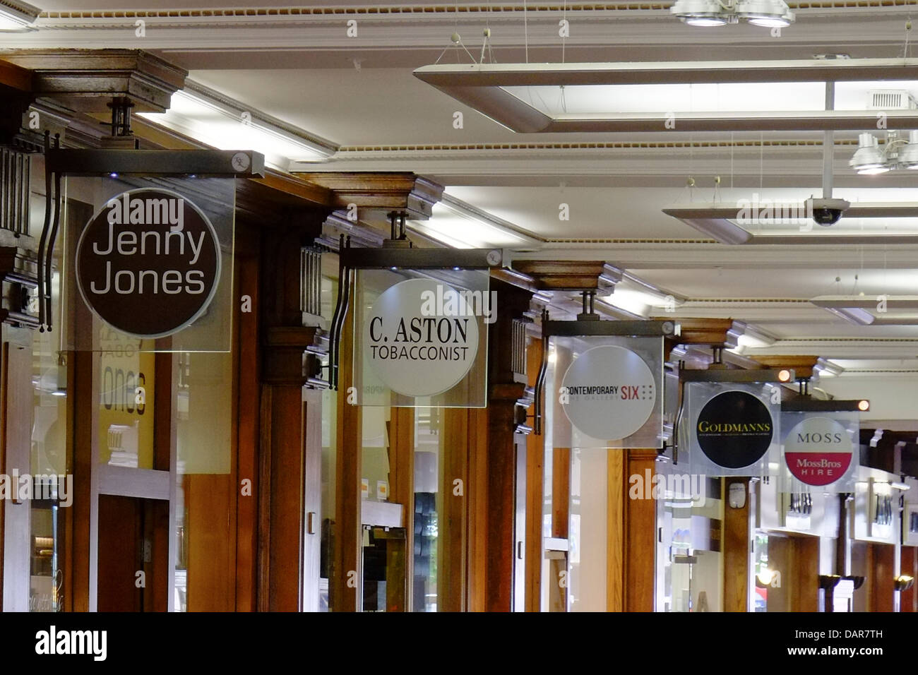 England, Manchester, detail of shop signs underneath The royal Exchange Theatre - Stock Image